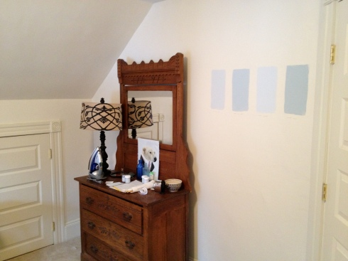 "Choosing a paint color. We went with Benjamin Moore's ""Constellation,"" ironically."